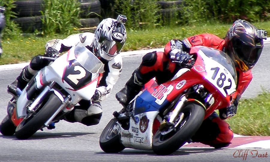 Two motorcycles fighting for the lead.