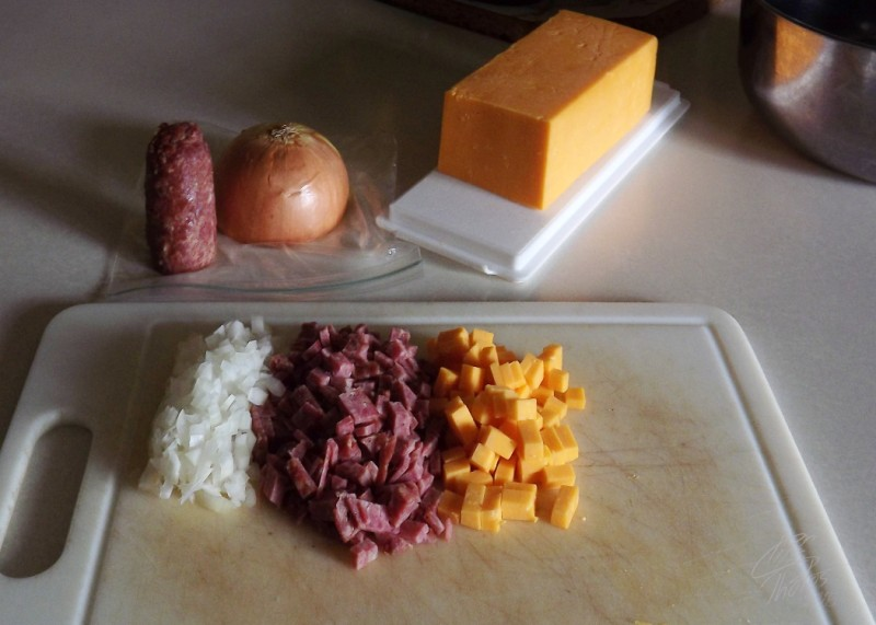 "I wanted a savory snack thing. I used white onion, left over farmer sausage, and some very nice ""old"" cheddar."